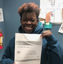 Employee Holding Up Certificate